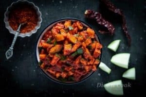Raw mango pickle with step by step photos and video. Vegan and glutenfree recipe. #pickle #Indian #glutenfree #vegan