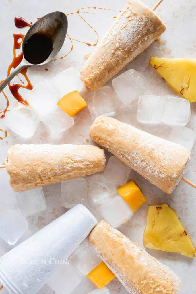 Homemade creamy tropical fruits popsicles is easy recipe with just 6 wholesome ingredients. A healthy dessert to beat the summer heat. This is sugar free recipe with nutty flavour of almond on every bite of popsicle. It just takes 5 minutes to blend them together, pour and freeze. #popsicle #creamy #summer #recipes #icecream