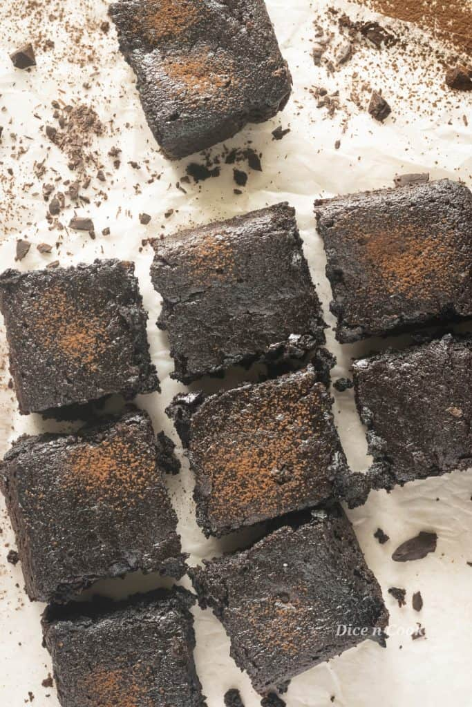 Avocado brownies are eggless, dairy free, delicious, and super-moist. Healthy decadent nut-free fudgy brownies. These are guiltfree amazingly rich double chocolate brownies #brownies #chcocolate #avocado #healthy #easy