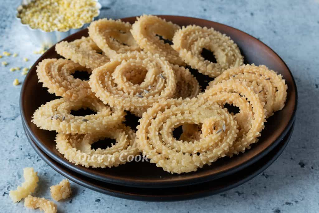 Moong dal chakli or hesaru bele chakli recipe with step by step photos and a quick detailed video. Moong dal chakli is deep fried South Indian snack. These are made of combination of rice flour and lentils. This is a easy and simple recipe.
